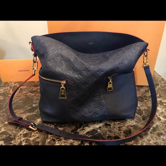 3e17a53ede24 Louis Vuitton Handbags - Louis Vuitton Melie in Marine Rouge